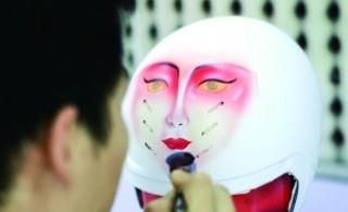 自行车夺冠手绘脸谱头盔惊艳里约 网上已现仿制品图片