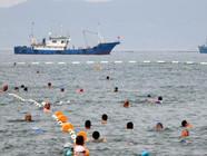 青岛清理海滩迎客来