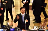 国家税务总局局长王军。 人民网记者翁奇羽 摄