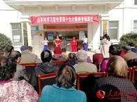 沭阳县学习十九大报告进社区活动走进山羊村。