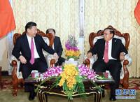 习近平同老挝国家主席本扬会谈:打造中老命运共同体
