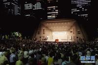 这是9月19日在日本东京拍摄的集会现场。当日,近5000人在东京日比谷公园内参加反对新安保法集会。新华社记者 杜潇逸 摄