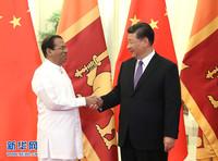 5月14日,国家主席习近平在北京人民大会堂会见来华出席亚洲文明对话大会的斯里兰卡总统西里塞纳。 新华社记者 姚大伟 摄