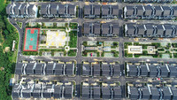 2020年7月23日,俯瞰浙江省湖州市德清县阜溪街道龙胜村,一幢幢白墙黛瓦的新农居房在低丘缓坡拔地而起。
