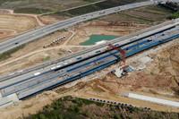 这是3月25日拍摄的引江济淮工程G312合六叶公路桥项目施工现场(无人机照片)。