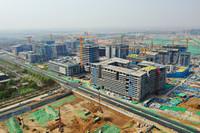 4月8日拍摄的雄安新区商务服务中心建设现场(无人机照片)。