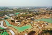 这是4月9日拍摄的雄安新区悦容公园建设现场(无人机照片)。