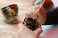 """6月12日,手工藝人在福建省武夷山市舉辦的""""文化和自然遺產日""""活動中展示黑釉茶盞制作技藝。"""