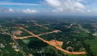 """这是文昌国际航天城起步区""""三横五纵""""路网工程施工工地(8月14日摄,无人机照片)。"""