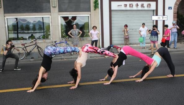 杭州女白领趁西湖人少马路上秀瑜伽