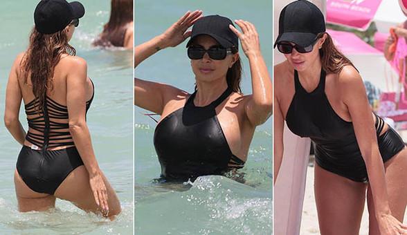 皮蓬前妻海滩度假秀上围 挂脖泳衣秀傲人上围