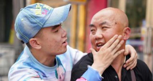 图片故事:摩托车上 父爱如山