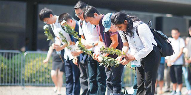 南京举行国际和平集会 各国青年祈愿和平
