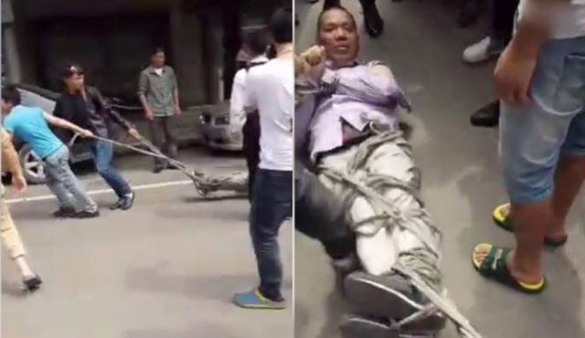 男子上门推销女主人晕倒 被拖游街倒吊打